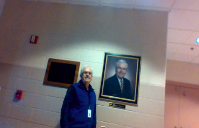 Mr.Trottier standing next to his picture in the main lobby. Make sure to take a look as you're passing by.