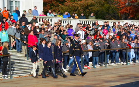 Wreath layers: Caroline Freeman, Alden Mehta, Camilla Manz, and Andrew Sedzia walking to the Tomb of Unknown Soldier.